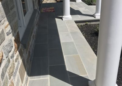 Front Portico with Stone Facade and Blue Stone Flooring